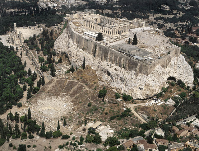 Color photo of the Acropolis taken from a helicopter, showing ruins of an ancient theater