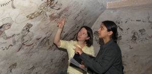 Stephanie Bogin and Madhu Rani assessing condition of wall paintings in the Sheesh Mahal. © Courtauld Institute of Art