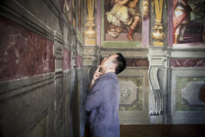 Chinese scholar and Connecting Art Histories participant Liang Guo views frescoes in the Casa Vasari palace in Florence, Italy. © J. Paul Getty Trust