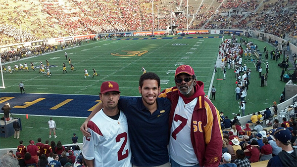 Getty intern Anthony Merrill with his father and brother at a Cal-USC game