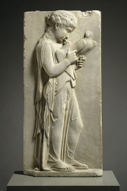 A Greek Marble Relief of a Young Girl Holding Doves