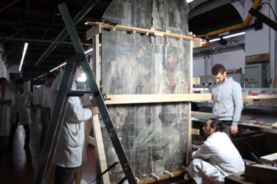 """Conservators position a panel of Vasari's """"The Last Supper"""""""