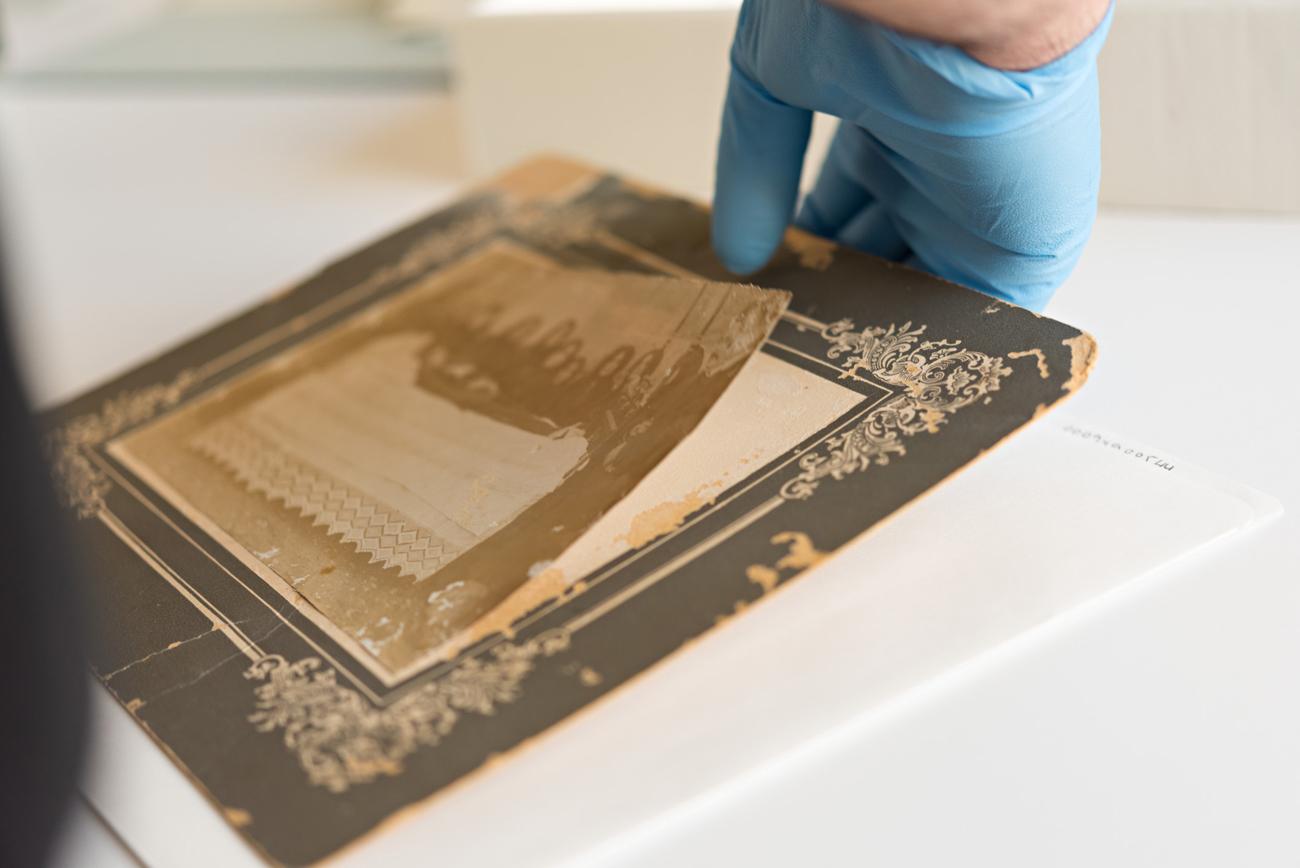 Handling a fragile, mounted gelatin silver POP print