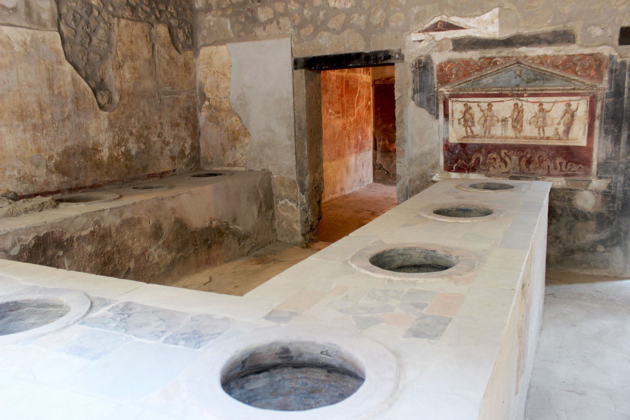 Interior of an ancient Roman fast-food establishment showing remains of cooking stations