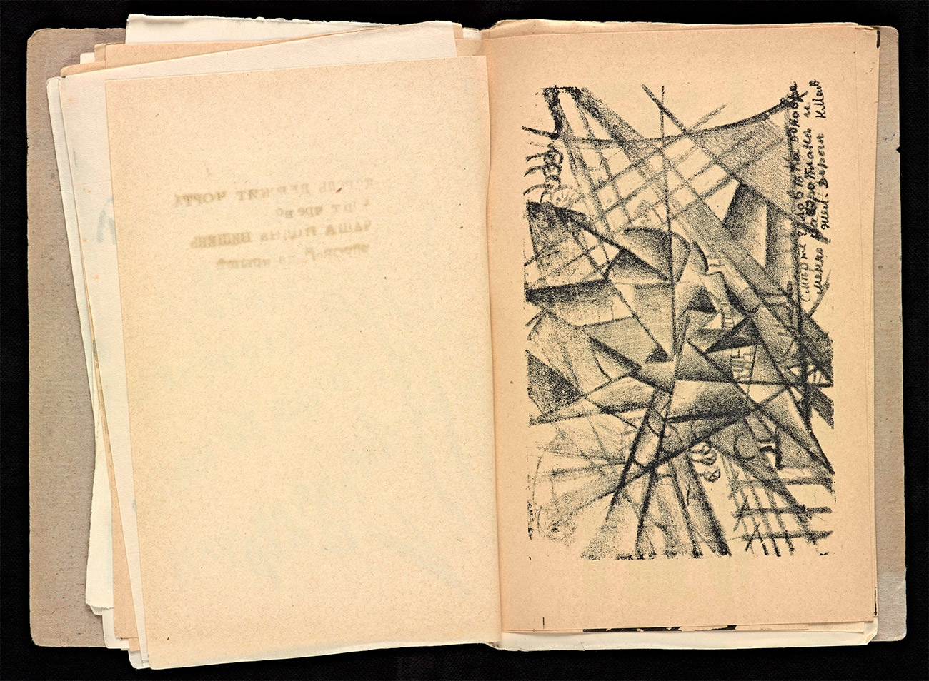 Book of yellowed pages open to a spred showing a lithograph of an abstracted, dynamic city scene