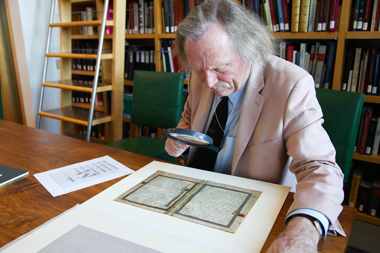 Lawrence Nees examines the text in a Getty Museum manuscript to identify it's scribe.
