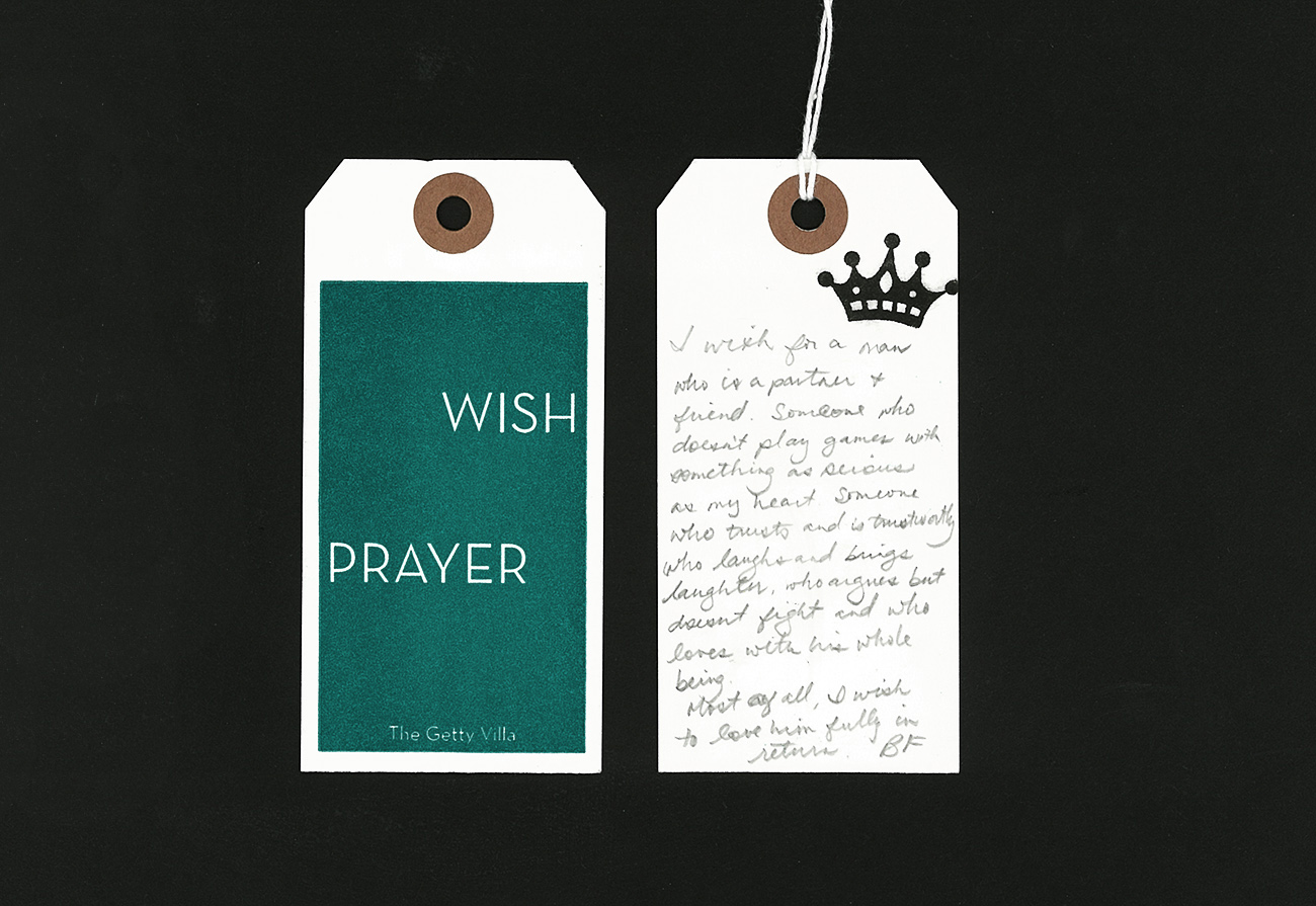 "Handwritten pencil prayer to Venus on a white tag that reads, ""I wish for a man who is a partner and friend. Someone who doesn't play games with something as precious as my heart. Someone who trusts and is trustworthy who laughs and brings laughter, who argues but doesn't fight and who loves with his whole being. Most of all I wish to love him fully in return —BF"""