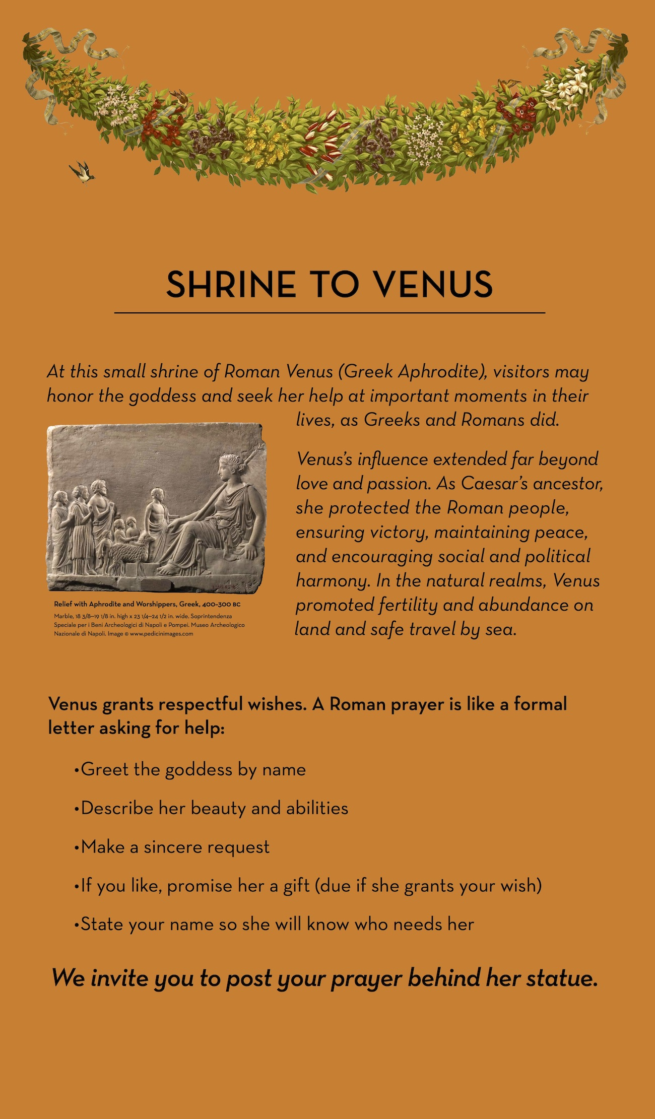 An orange sign with text describing a visitor activity to write prayers to the ancient goddess Venus