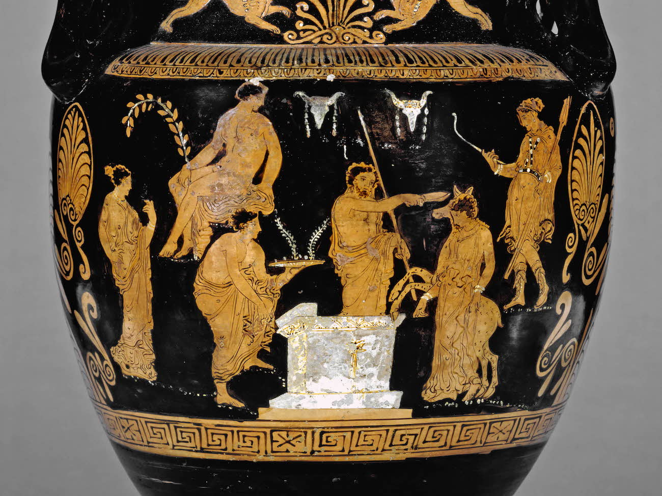 Detail of an ancient Greek red-figure vase showing a young woman being led to sacrifice