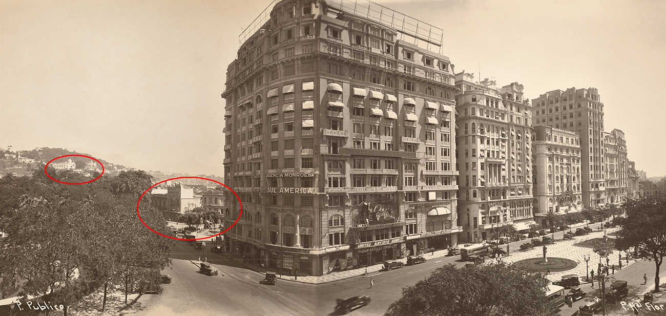 The black-and-white photograph shows a view of the Floriano Promenade in Rio, which is lined with multi-story buildings. To the left, older and smaller buildings are still evident in the city.