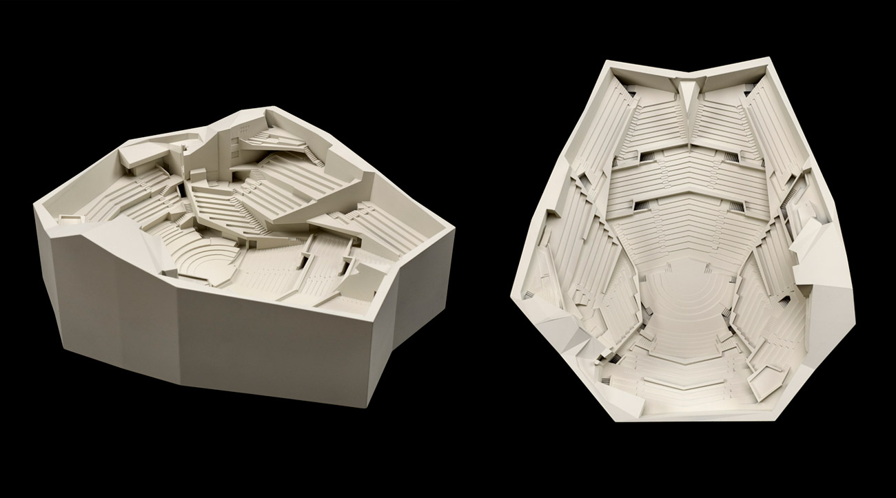 A model of a concert hall seen from the side and from directly above .