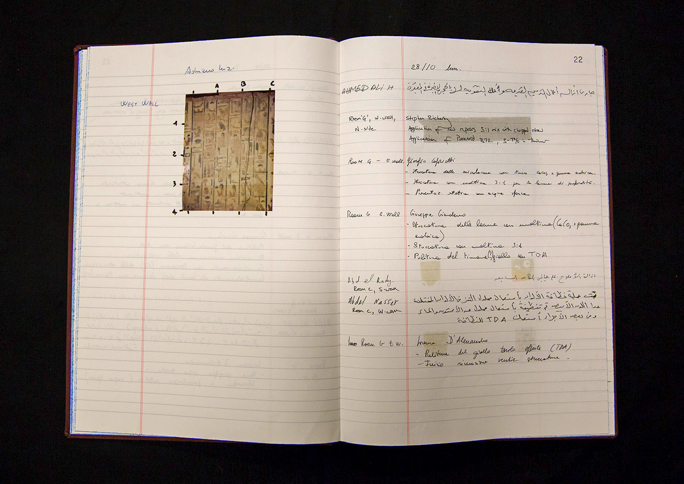 An open notebook shows a photo on the left marked with a grid and handwritten entries on the right.