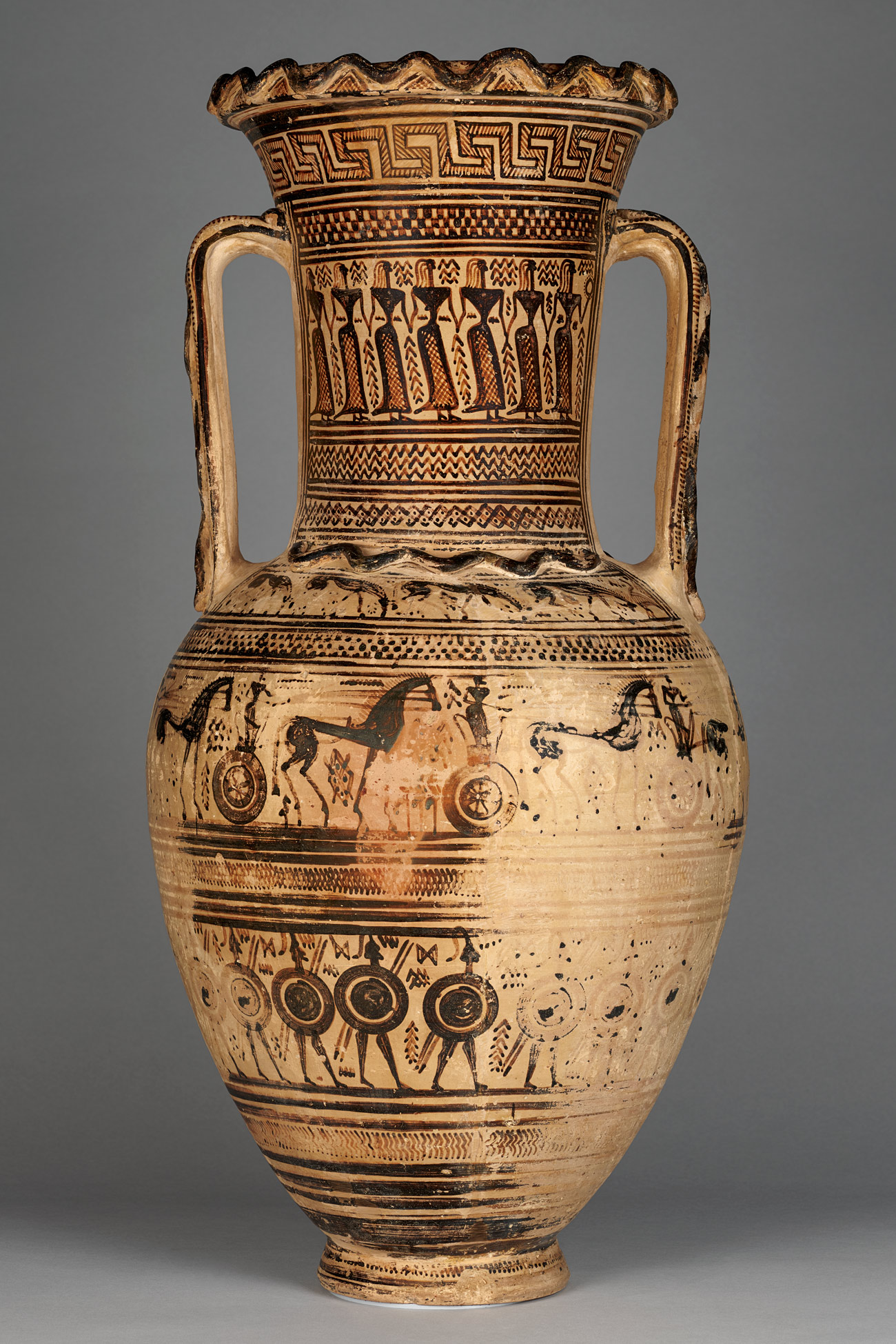 A ceramic vase faded on one side with patterned illustrations including rings of women holding hands, horses and soldiers