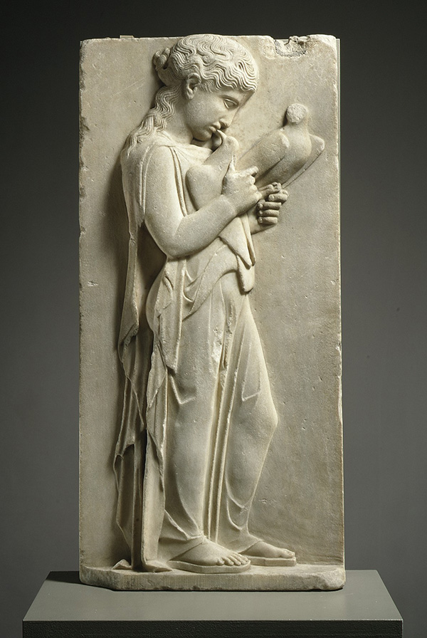 A Greek Marble Relief Of A Young Girl Holding Doves The
