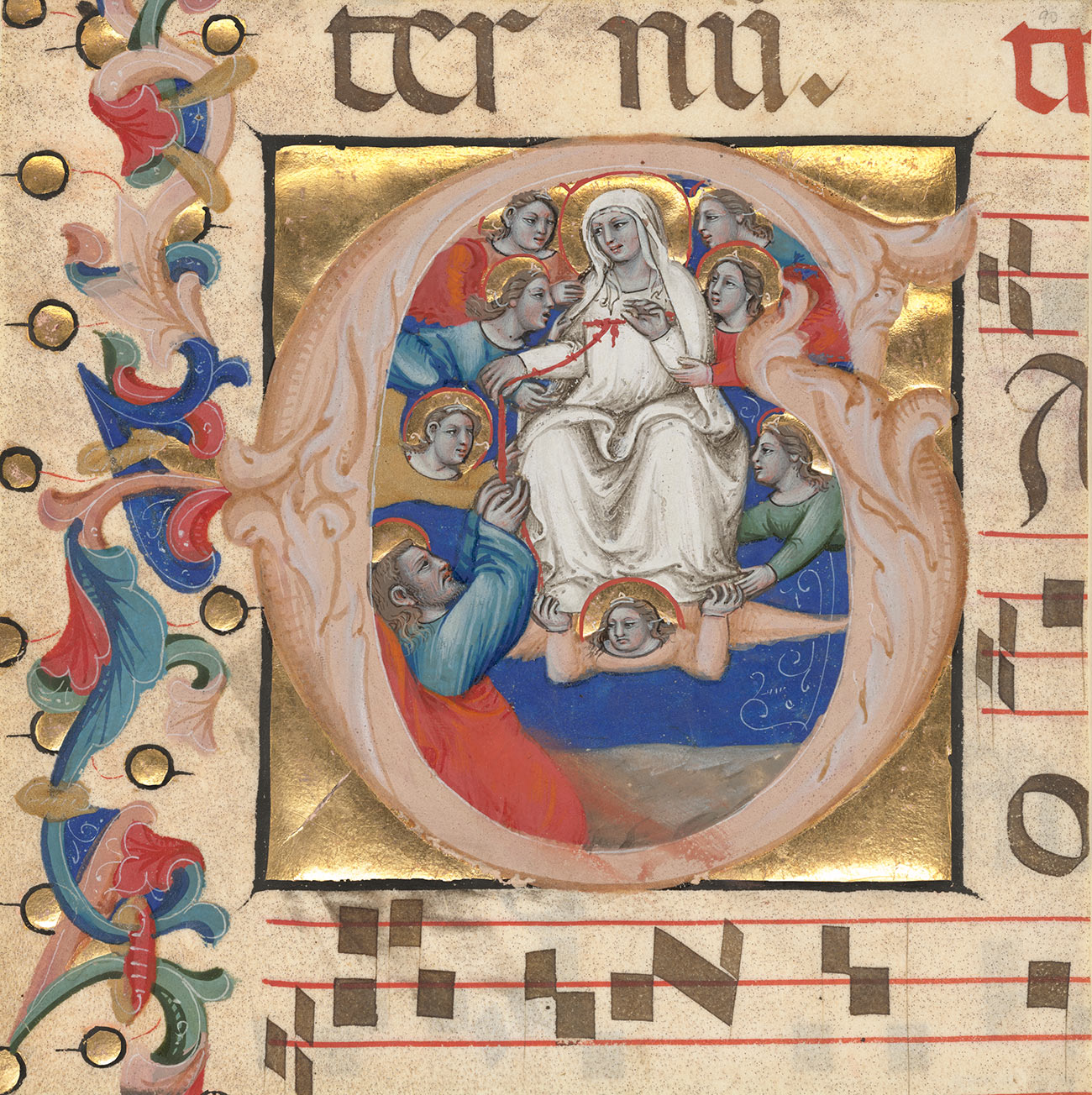 A detail of a medieval illumination inside of the letter G. At the center is the Virgin Mary dressed in all white.