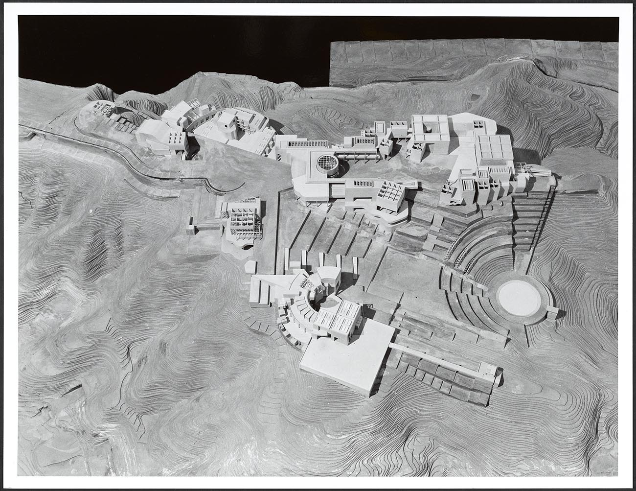 Black and white photograph of an architectural model of buildings from above