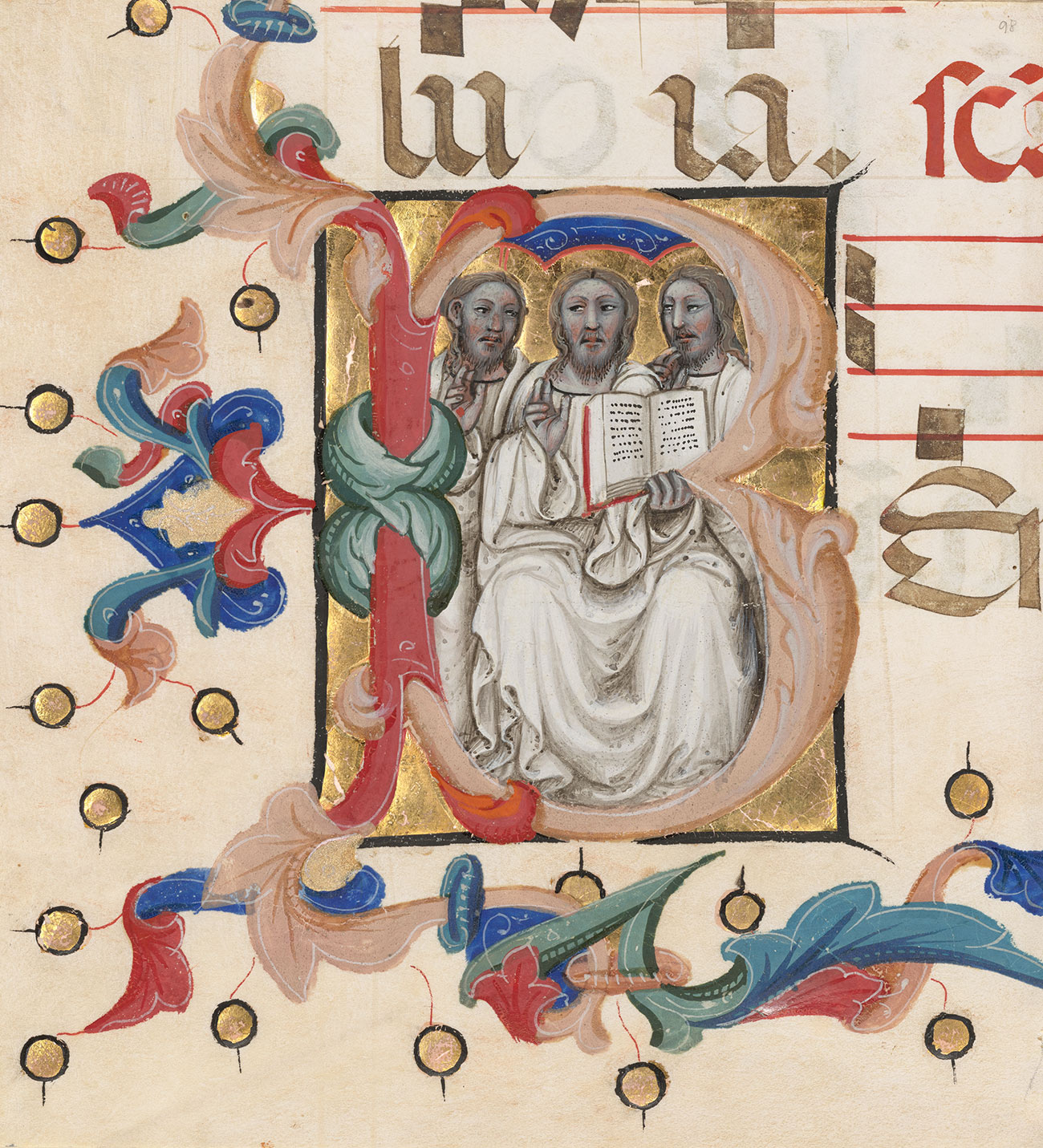 Three illustrated figures inside the initial B. The figure in the center holds an open book.