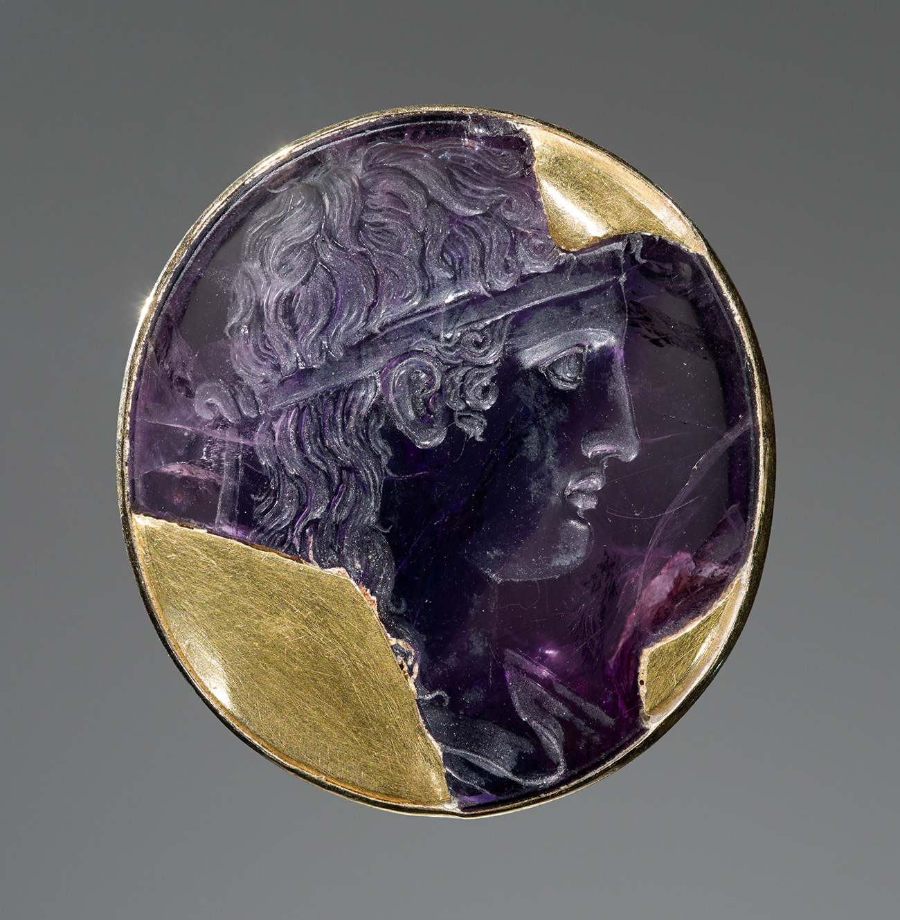 Luxurious carved amethyst carved with a portrait head of the god Apollo looking to the right