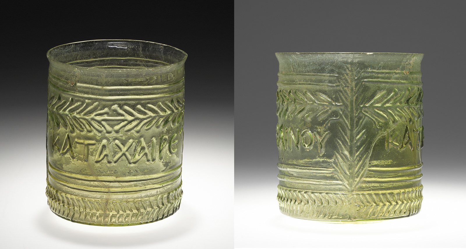 Two views of a stout drinking glass in green glass with raised decoration of letters and leaf shapes