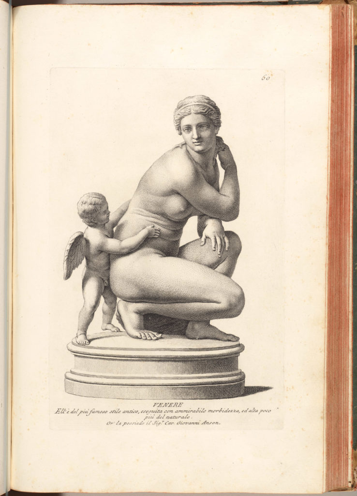 Photo of a book open to an engraving of a kneeling women with a cherub on a pedestal.