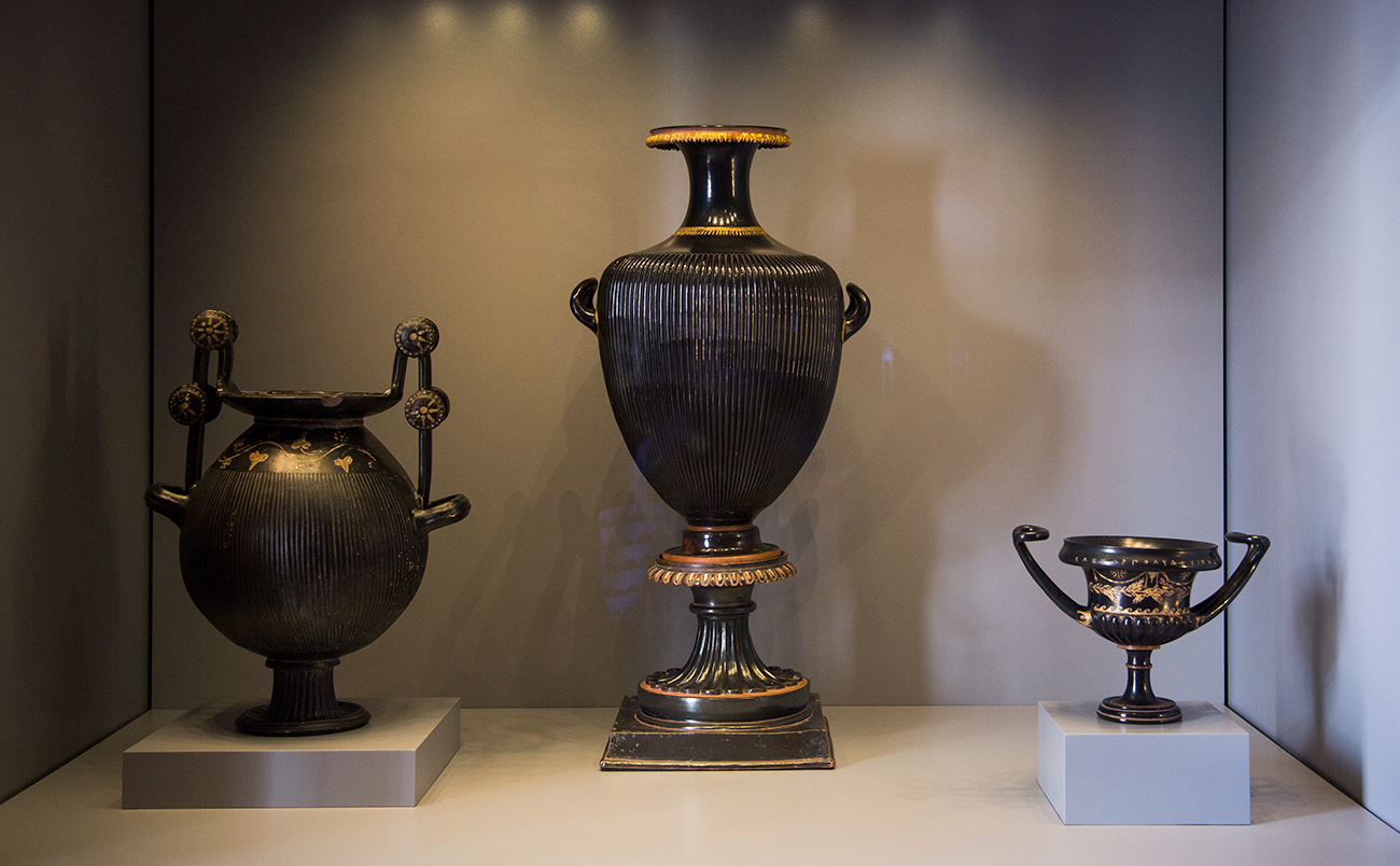 Three vases in a case at the Getty Villa.