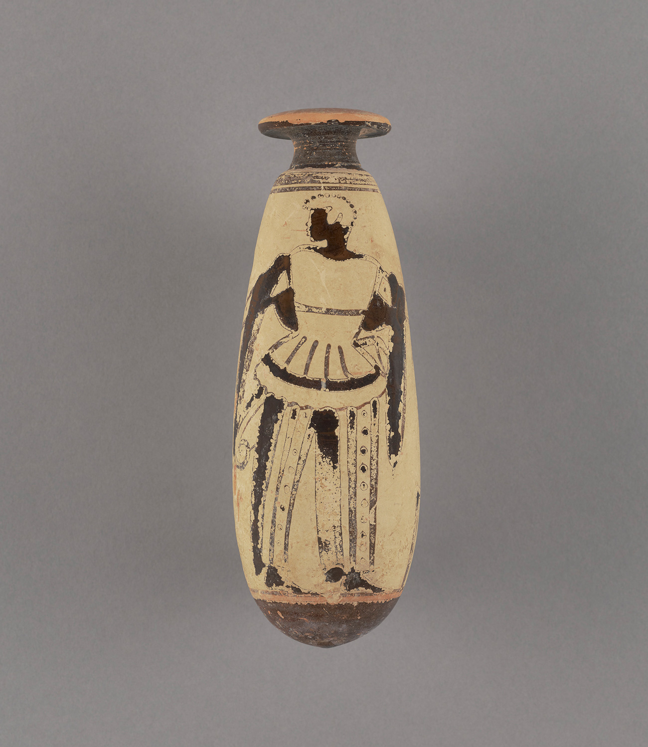 A small, narrow vase shows a man with black sink standing in elaborate garments