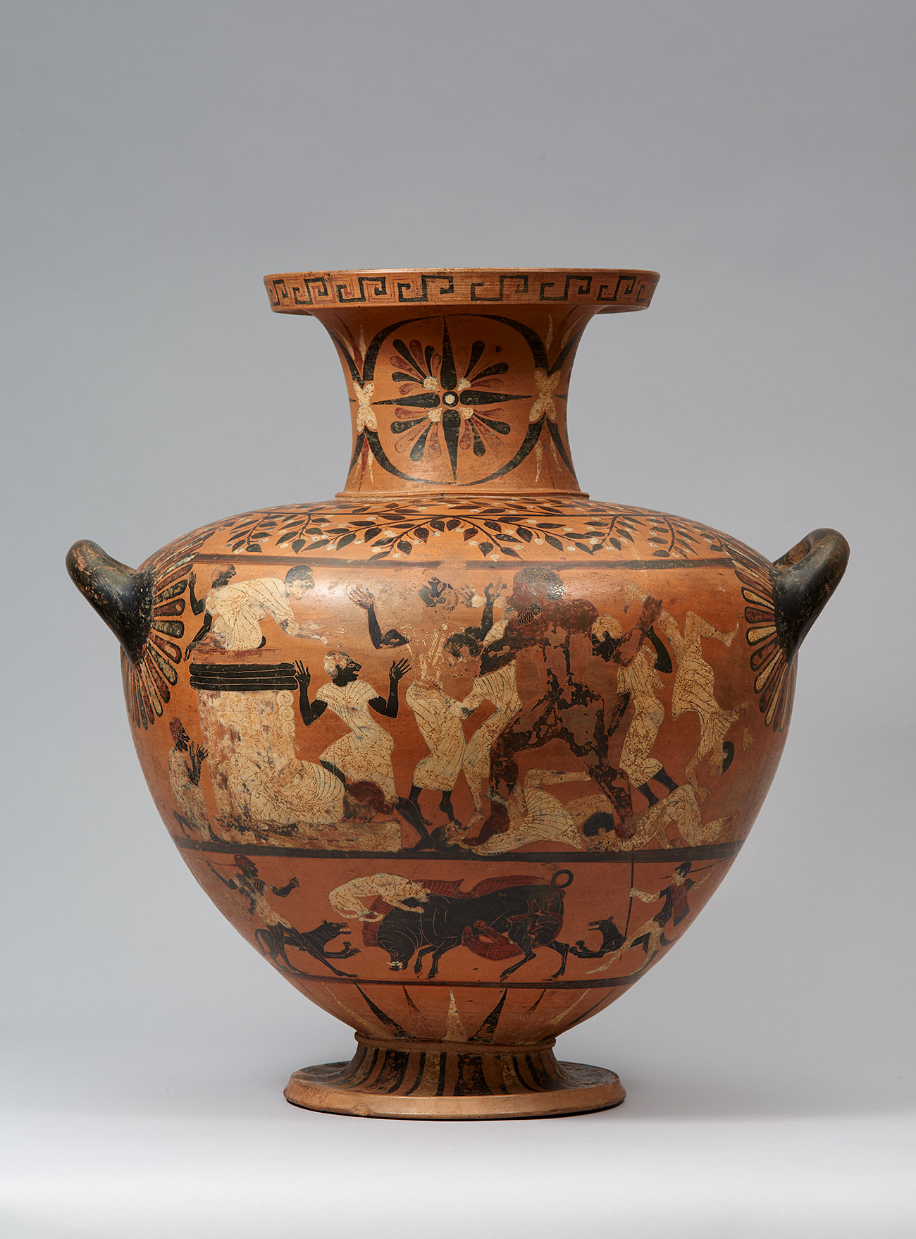 A bulbous jar with a tall lip and two small handles is painted with figures in black and white skin tones