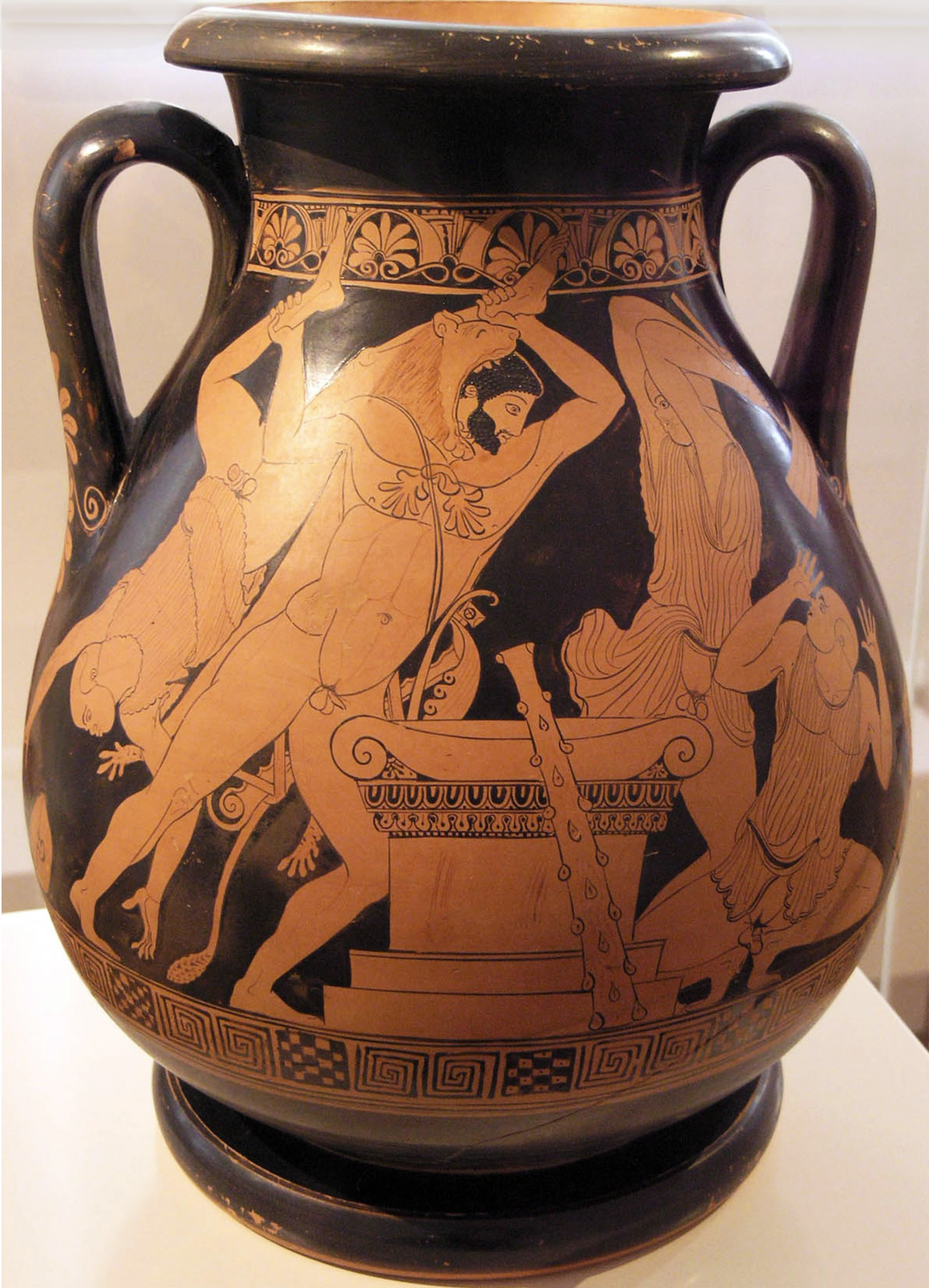 An ancient Greek vase in a display case shows Herkales battling a man with African features