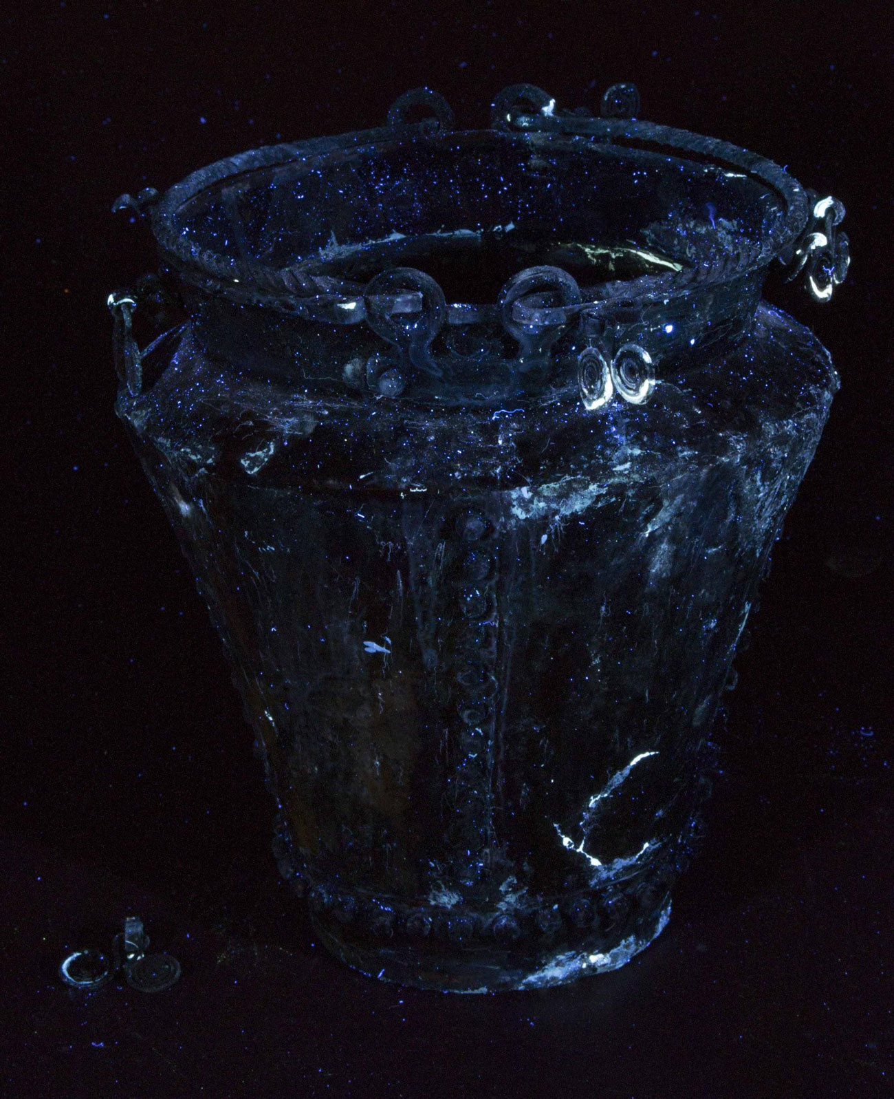 A dark image of a bucket vessel showing faint swirls and patches