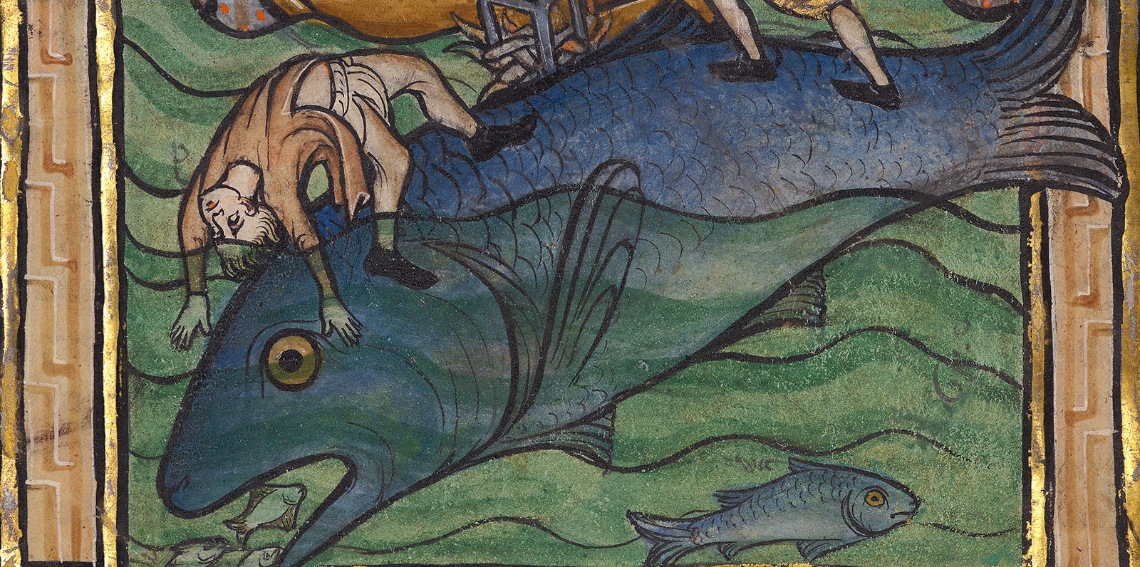 A man is carried away in the water by a large fish-shaped whale