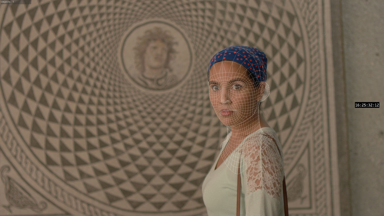 A woman with a spotted cap covering her hair stands in front of a mosaic. A grid maps the shape of her face.