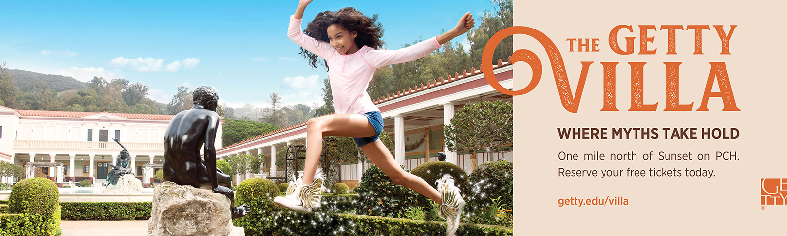 In a billboard ad, a tweenage girl leaps for joy, silhouetted against a blue sky in the garden of the Getty Villa