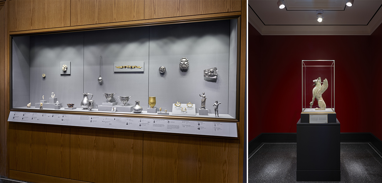 Left: A long shallow case set into a wood-paneled wall displays several gold and silver objects, including masks, vessels, and figurines, in the new Roman Treasury. Right: A bronze statue of an Iberian winged lion created in the fifth century B.C. displayed in a single vitrine is the only object that occupies a small red-walled gallery.