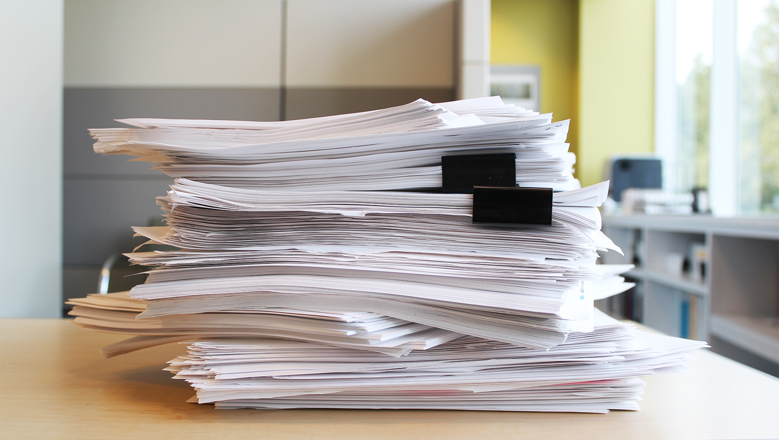 A stack of white papers for editing.