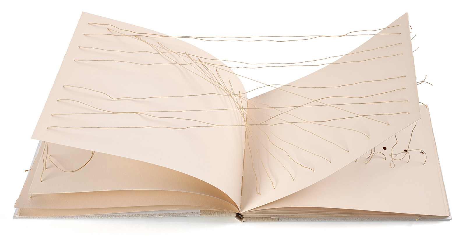 Kevin Smith's book titled Book 91 featuring white pages with red string that is strung through each page.