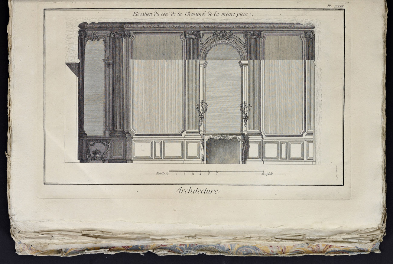 "Antique book open to an engraved illustration of a wall and fireplace with the title below ""Architecture"""