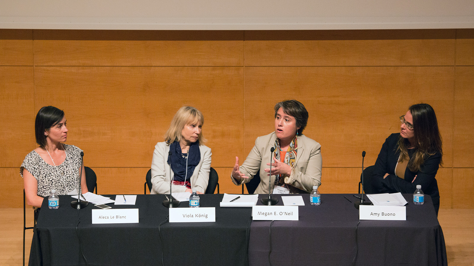 Four women at a panel discussion.