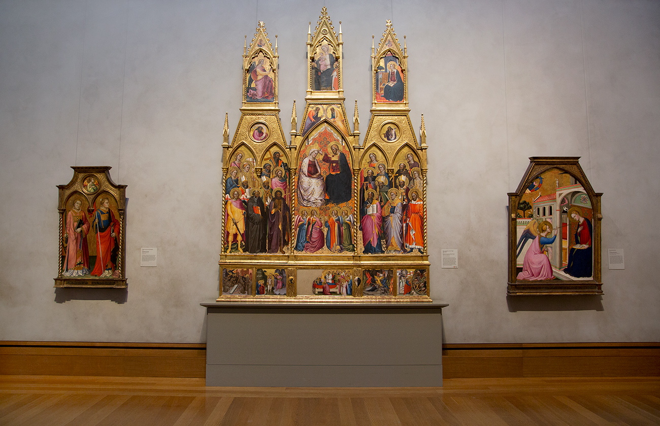 The finished rehang in the Renaissance panel painting galleries. Three paintings are in frame.
