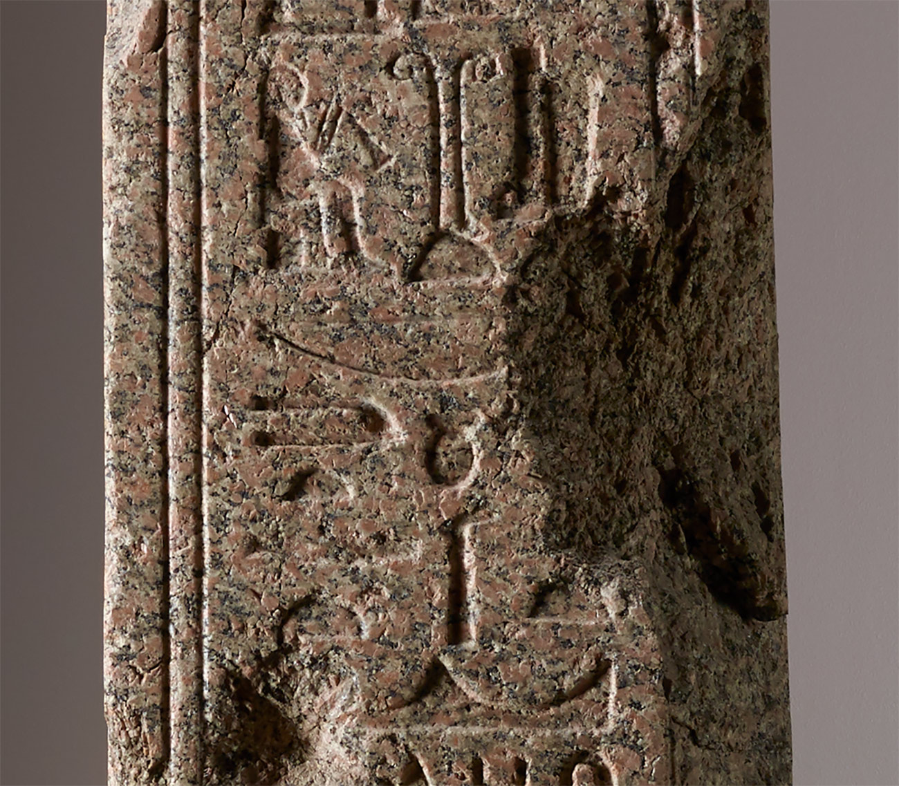 "Close-up of a reddish granite obelisk with Egyptian hieroglyphs spelling out the name ""Benevento"""