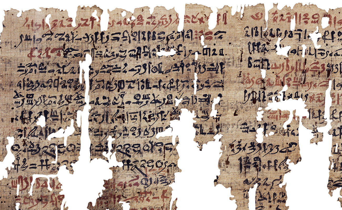 Detail of an ancient papyrus with black and red lettering in cursive Hieratic script