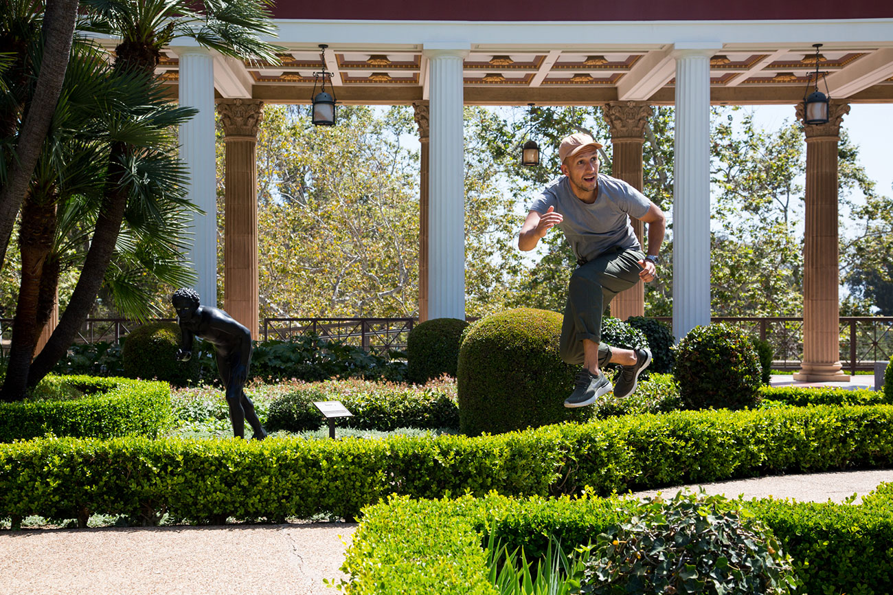 VICE jumping mid-air in the Getty Villa gardens