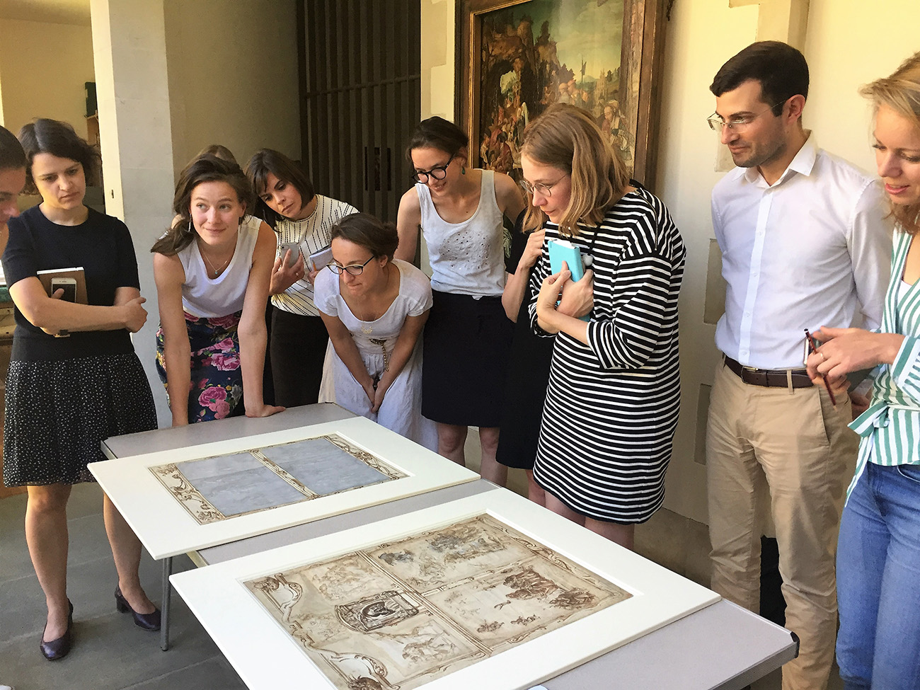 Participants examine Old Masters drawings.