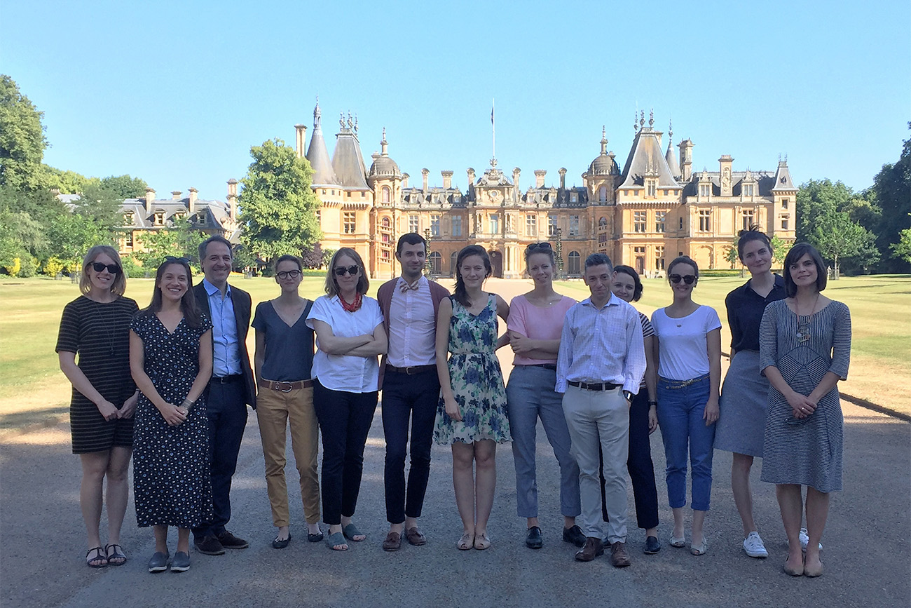 13 participants stand in front the large and opulent Waddesdon Manor