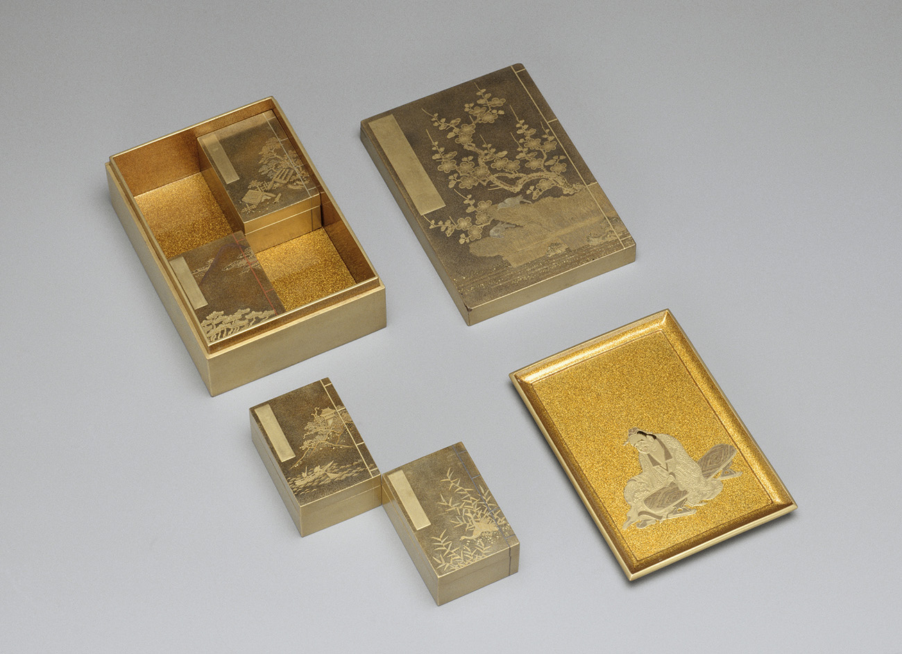 A rectangular box open for display with its contents showing. A tray has been removed and four smaller boxes fit underneath.