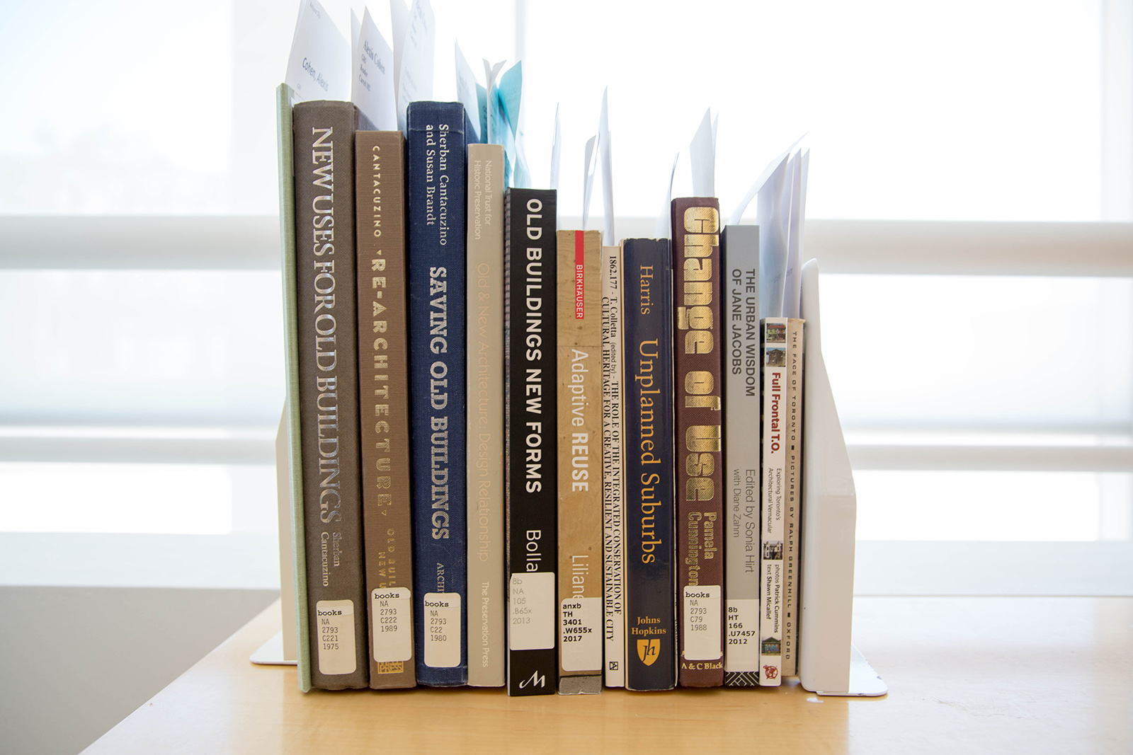 Stack of books related to Canadian architecture.