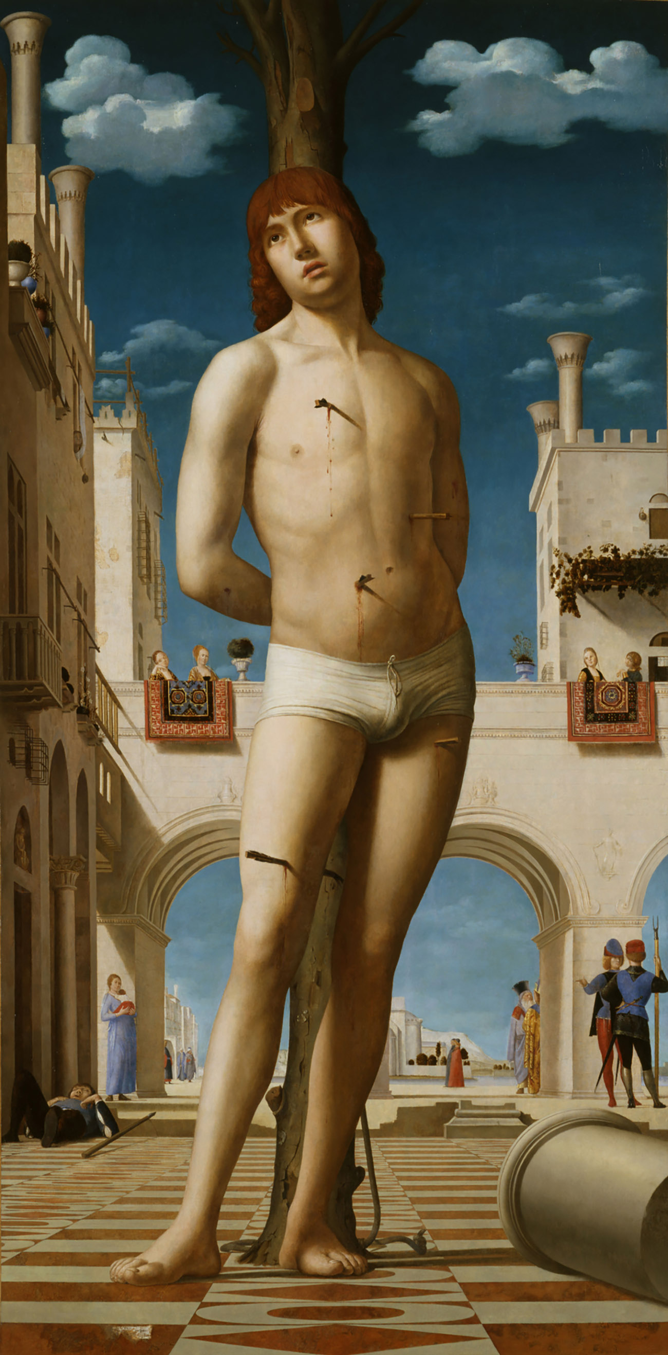 Saint Sebastian. A nude male tied to a post shot with arrows.