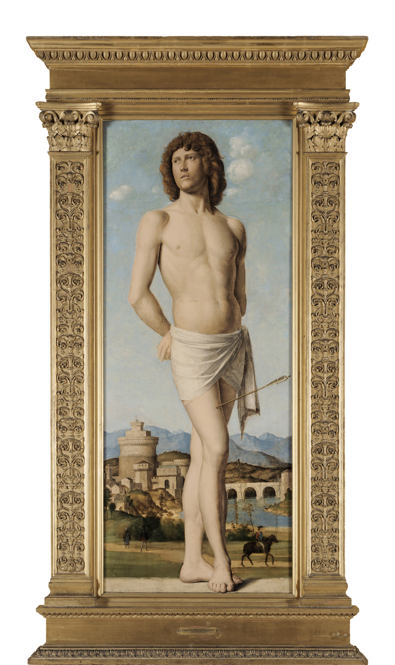 A nude muscular male standing in front of a landscape scene.