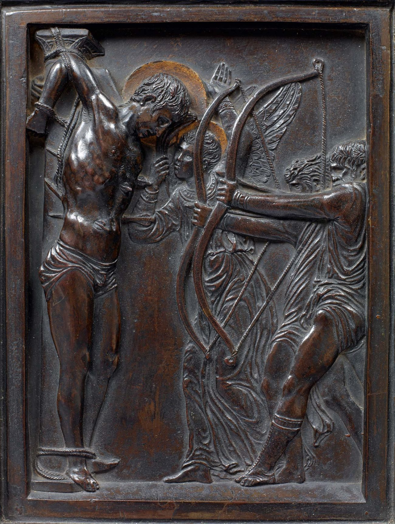 Bronze low relief sculpture of men attacking a nude Saint Sebastian with arrows.