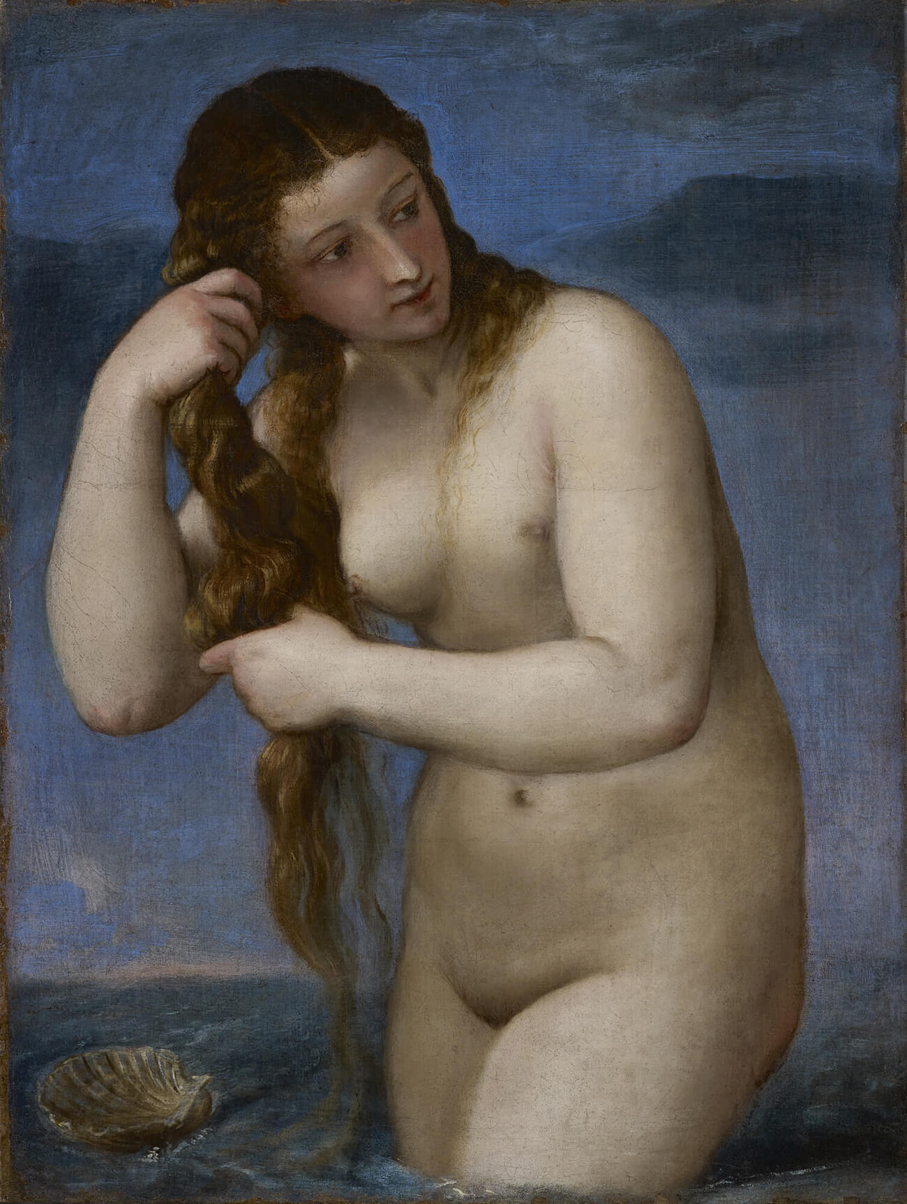 Nude Venus standing in water beside a shell, wringing water from her hair.