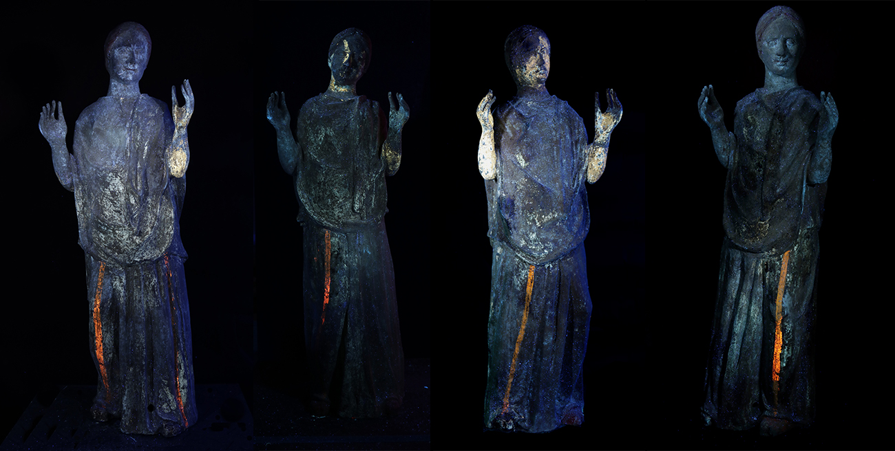 The four mourners photographed in a dark blue ultraviolet light that shows traces of pigment that are unseen with the naked eye.